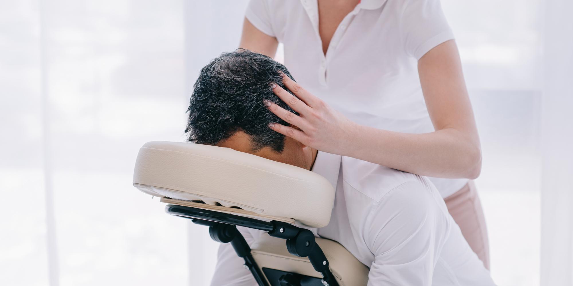 Business Man getting Head massage in office